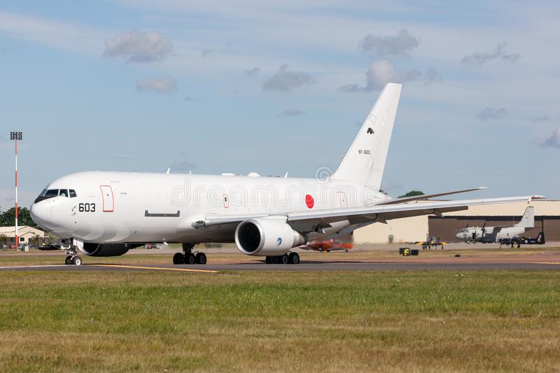 Japan Air Self-Defense Force JASDF Boeing KC-767J aerial tanker aircraft 97-3603. RAF Fairford, Gloucestershire, UK - July 14, 2014: Japan Air Self-Defense royalty free stock photography
