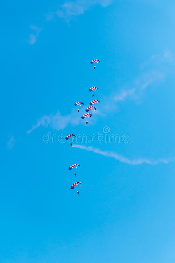 RAF Falcons Parachute Display at Swansea Air Show. Swansea, United Kingdom - June 30, 2018: RAF Falcons parachute display team performing at the Air Show in stock images