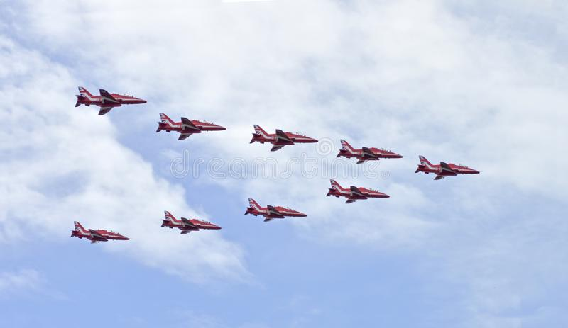 The RAF Red Arrow flying above the city of Ottawa. Ottawa, Ontario, Canada, August 13, 2018: The Red Arrows elite flying team from The Royal Air-force in Great stock images