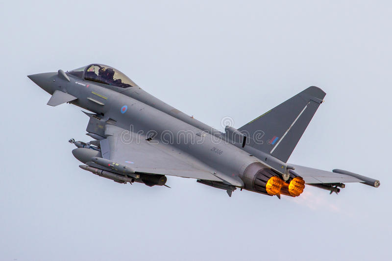 RAF Typhoon Low Approach. RAF FAIRFORD, UK - 6 JULY: An Royal Air Force Eurofighter Typhoon performs a low approach at The Royal International Air Tattoo on 6th royalty free stock photography