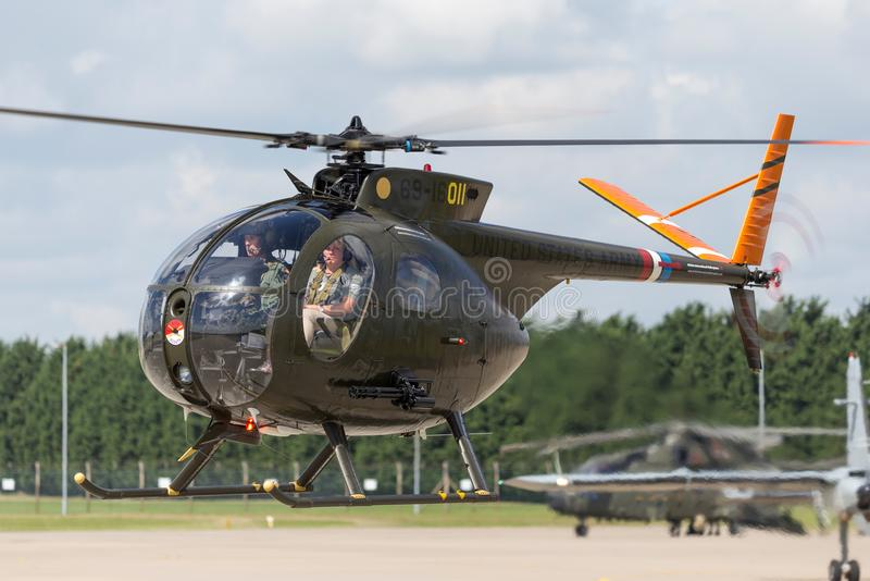 Former United States Army Hughes OH-6A Cayuse 69-16011 military helicopter G-OHGA. RAF Waddington, Lincolnshire, UK - July 7, 2014: Former United States Army stock photos