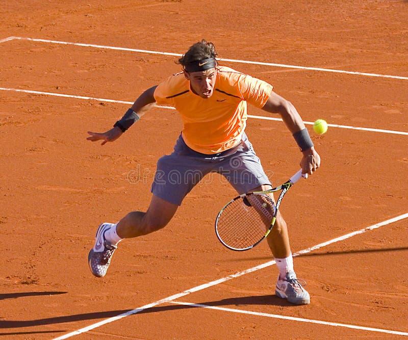 Rafael Nadal in action. BARCELONA - APRIL 29: Spanish tennis player Rafael Nadal in action during his final match against David Ferrer at Barcelona tennis royalty free stock images