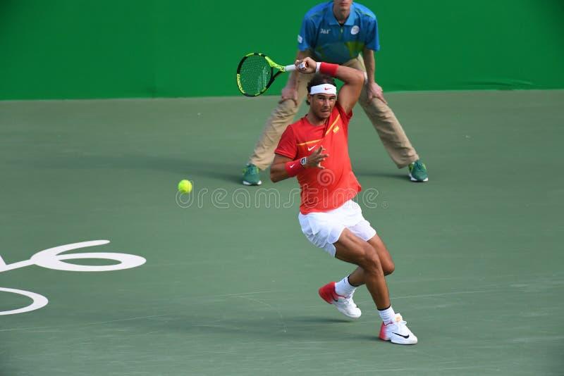 Rafael Nadal som spelar tennis fotografering för bildbyråer