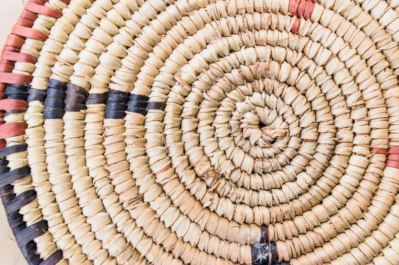 Raffia Place Mat Extra Rough Plaiting Grunge Texture Detail. Traditional handcraft weave Thai or African style pattern nature back stock photography