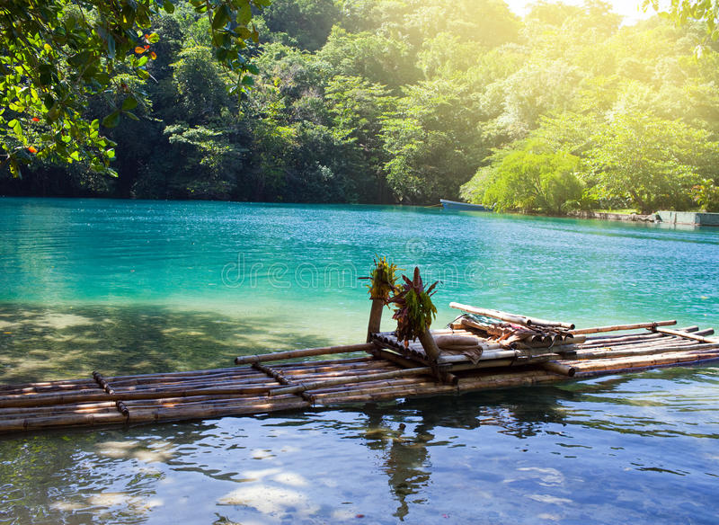 Raft on the bank of the Blue lagoon, Jamaica. Raft on the bank of Blue lagoon, Jamaica royalty free stock photo