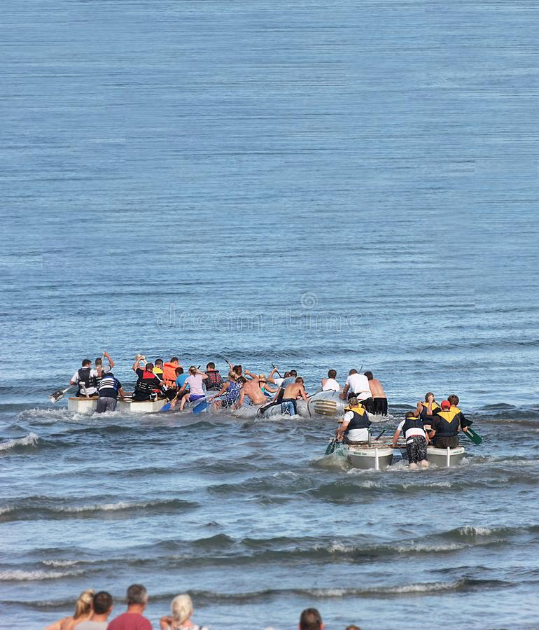 Raft race in the Irish sea ocean at Antrim Northern Ireland 2017 with foreground for editors text copy stock photos