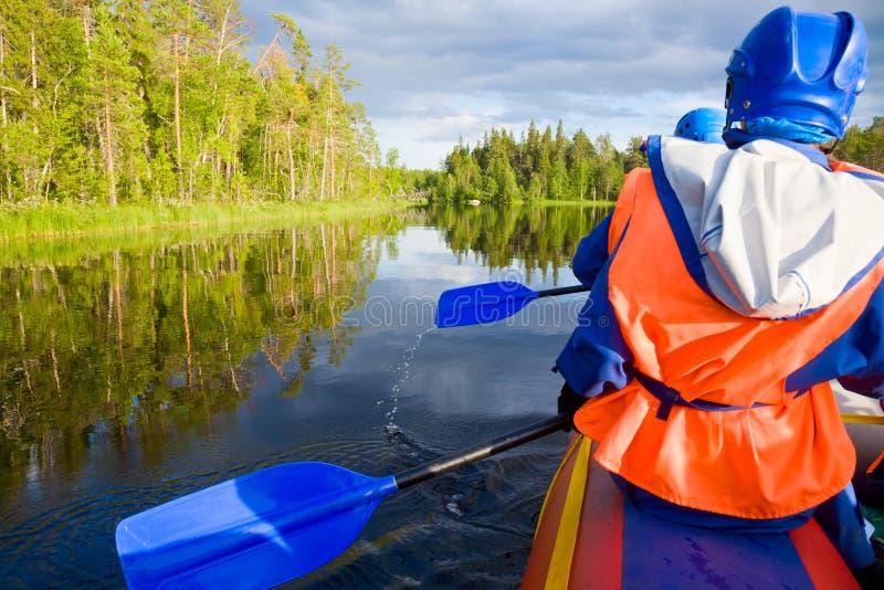Rafting. Rafters in a rafting boat on Pistojoki river in Karelia, Russia royalty free stock photos