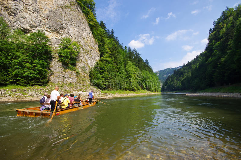 Rafting on Dunajec river, Poland. DUNAJEC RIVER, POLAND - AUGUST 11, 2015: traditional boat during the rafting. It is one of oldest and most famus entertainments royalty free stock photos