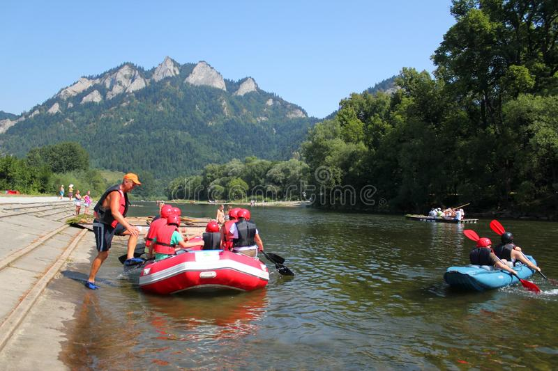 Rafting on Dunajec River, Poland. Dunajec River in Pieniny Mountains with Three Crowns Mount background, Poland stock photo