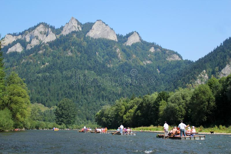 Rafting on Dunajec River, Poland. Dunajec River in Pieniny Mountains with Three Crowns Mount background, Poland royalty free stock photography