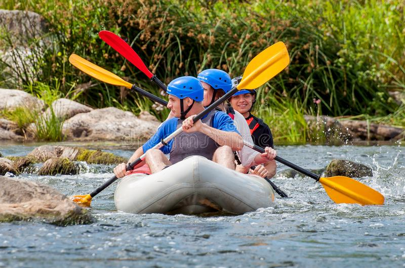 Rafting and kayaking. Extreme, emotional family and corporate rest. Ecological tourism. Teamwork. stock photography