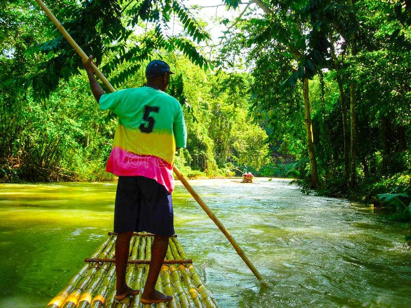 Jamaica Martha Brae River Guide on Raft stock photos