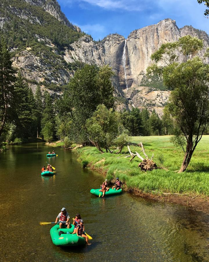 Rafting on the Merced. Families enjoy a rafting trip down the Merced River in Yosemite National Park royalty free stock photo