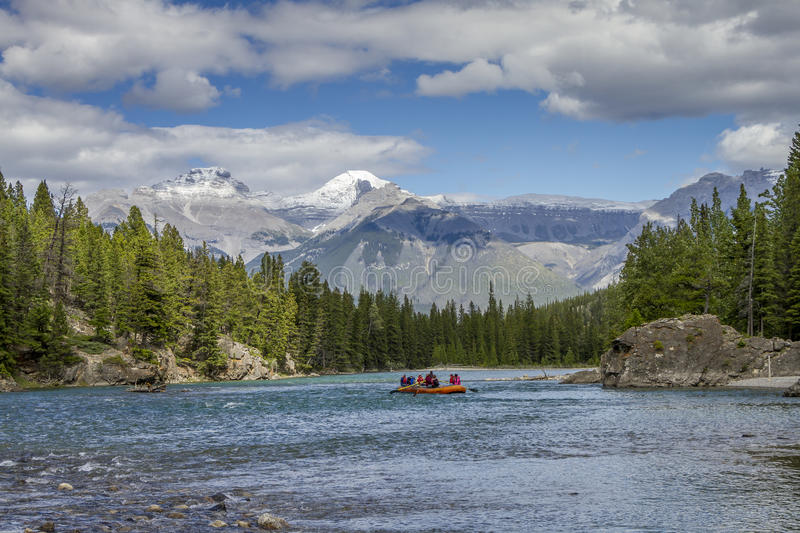 Rafting on a Mountain River - Jasper National Park, Canada. Rafting on the Athabasca River with the Rocky Mountains in the background - Jasper National Park royalty free stock photo