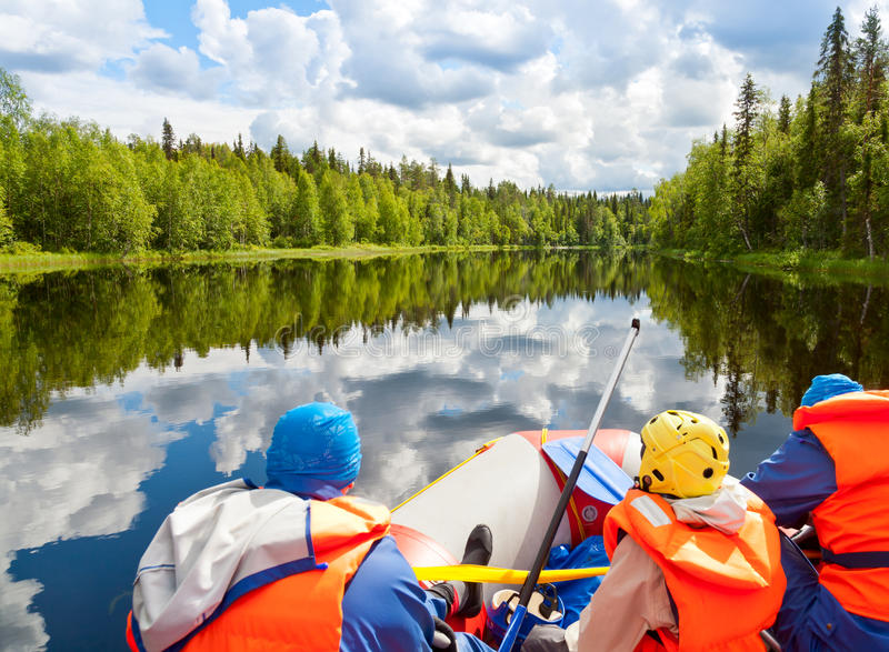 Rafting. Rafters in a rafting boat on Pistojoki river in Karelia, Russia stock photography