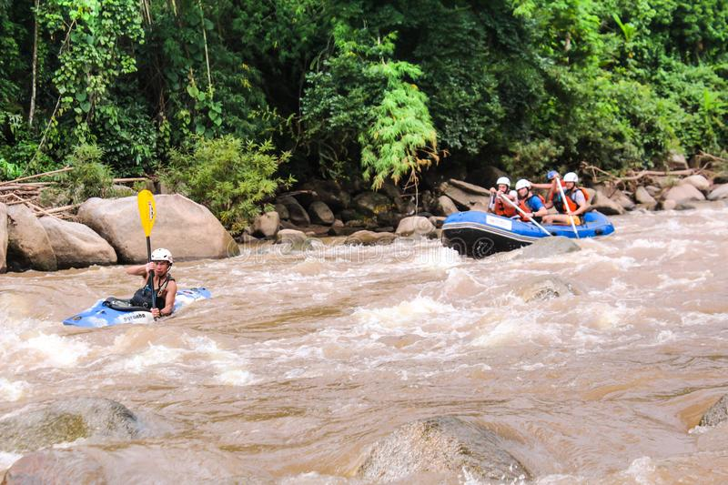 Mae Taeng,Chiang Mai/Thailand - August 3 Male and female tourists rafting at kued rive August 3,2017 Chiang Mai, Thailand stock photo