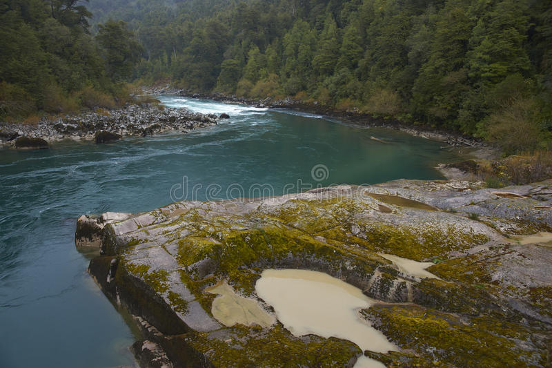 Rafting river of Patagonia. River Futaleufu flowing through mist shrouded forests in the Aysen Region of southern Chile. The river is renowned as one of the royalty free stock photos