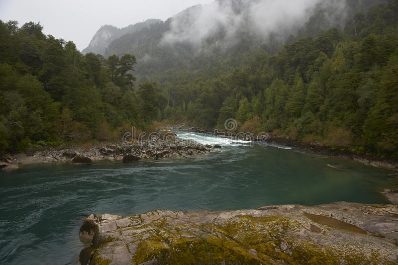 Rafting river of Patagonia. River Futaleufu flowing through mist shrouded forests in the Aysen Region of southern Chile. The river is renowned as one of the stock image