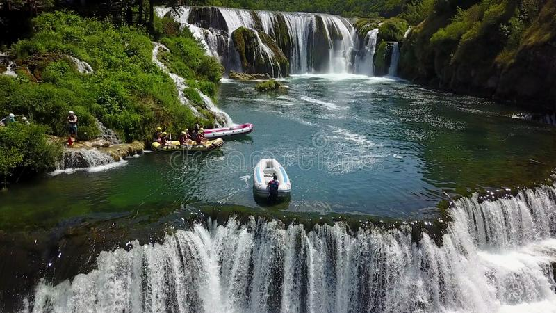 Rafting on the river Una. Štrbački buk is a 24 m high waterfall on the river Uni near the village of Kulen Vakuf and Orašac, which is located near the royalty free stock images