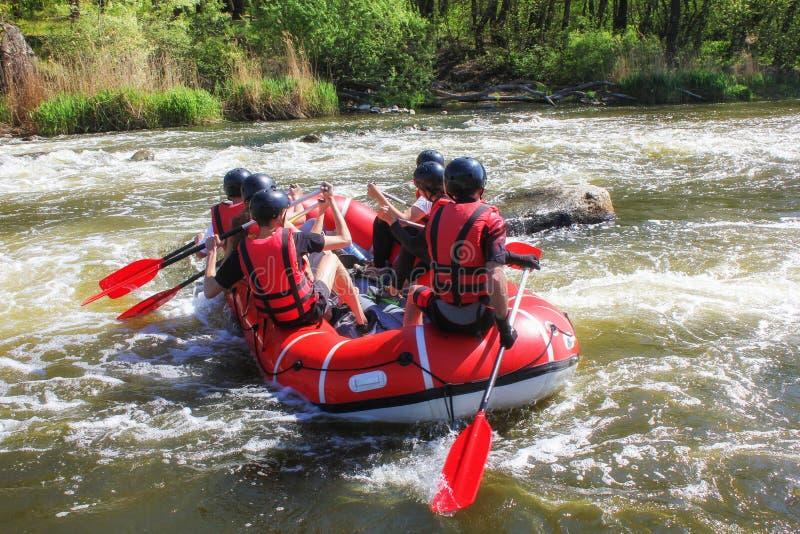 Raftingsteam, sport van het de zomer de extreme water stock foto's