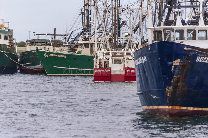 Rafts of fishing boats on New Bedford waterfront. New Bedford, Massachusetts, USA - October 12, 2019: Commercial fishing vessel Jonathan Ryan, hailing port New stock photo