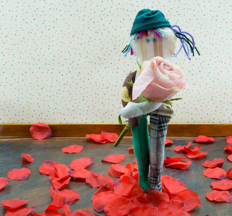 Rag doll boy with pink rose royalty free stock images