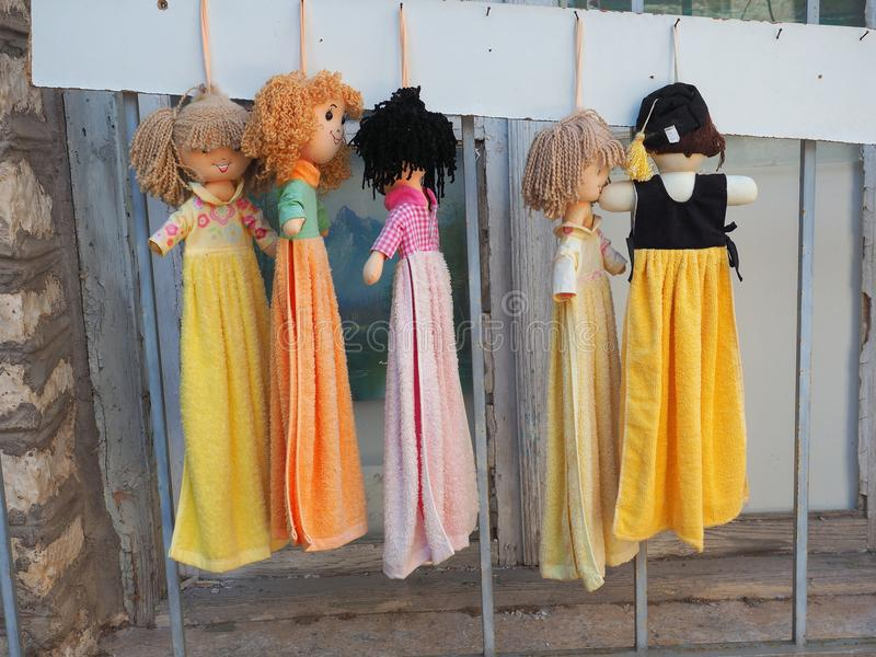 Rag Doll Hand Towls. Hand towels with curly haired dolls heads, for sale at a Greek souvenir and handicrafts shop, Greece stock photos