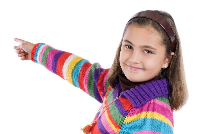 Ragazza adorabile con indicare di lana del rivestimento fotografia stock