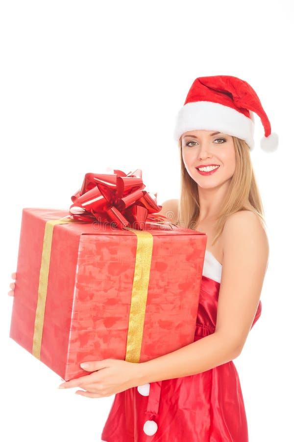 Ragazza allegra dell'assistente della Santa con il grande contenitore di regalo immagini stock