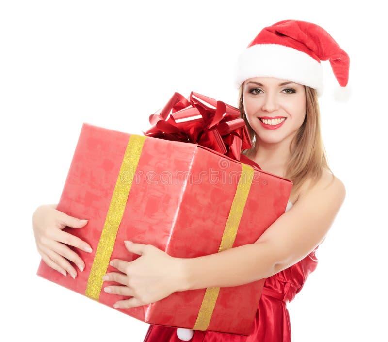 Ragazza allegra dell'assistente della Santa con il grande contenitore di regalo fotografia stock