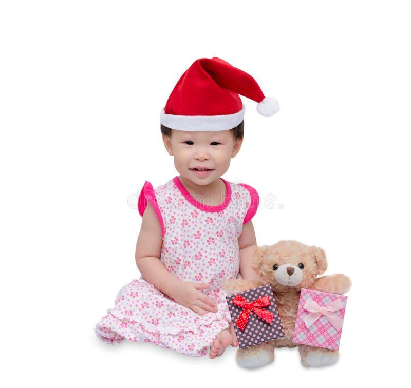 Ragazza asiatica felice con il cappello di natale fotografia stock libera da diritti