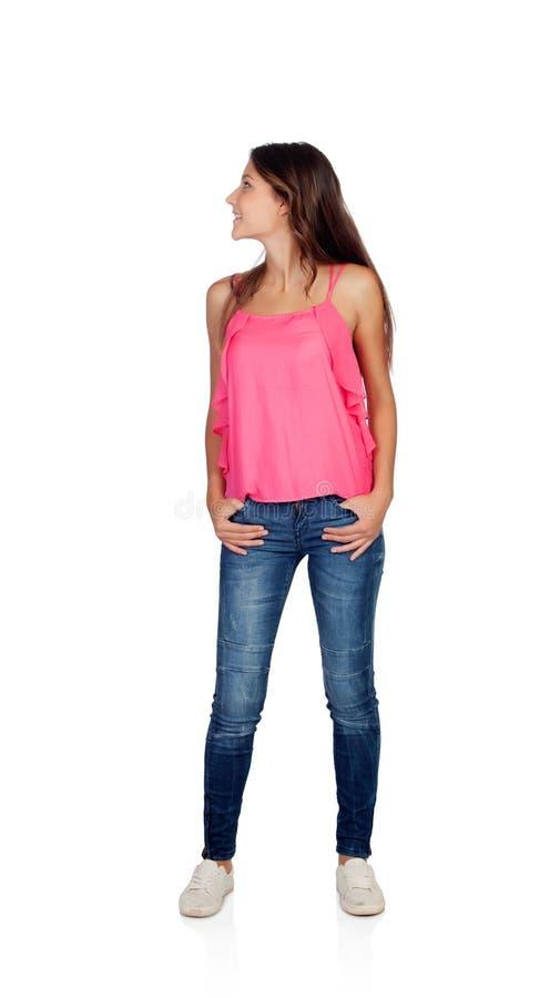 Ragazza attraente con i jeans che guardano indietro fotografie stock
