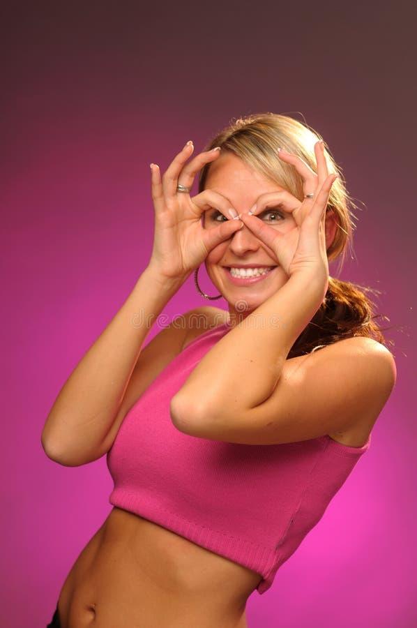 Ragazza attraente nel colore rosa fotografia stock