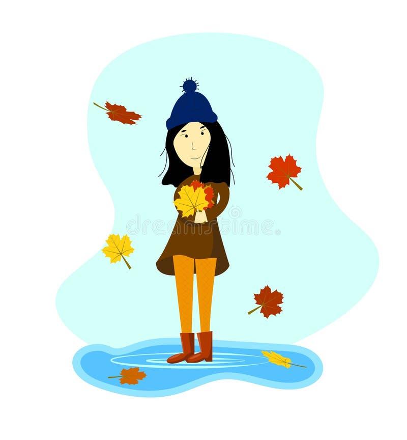 Ragazza in autunno con le foglie cadute variopinte in mani royalty illustrazione gratis