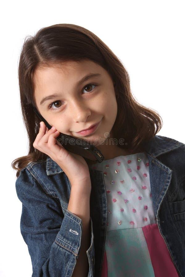 Ragazza/bambino con il telefono delle cellule fotografie stock libere da diritti