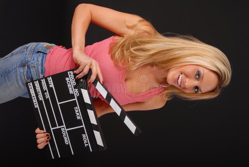 Ragazza bionda con l'assicella del cinematografo fotografia stock