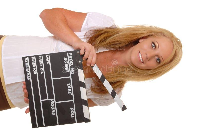 Ragazza bionda con l'assicella del cinematografo fotografia stock libera da diritti