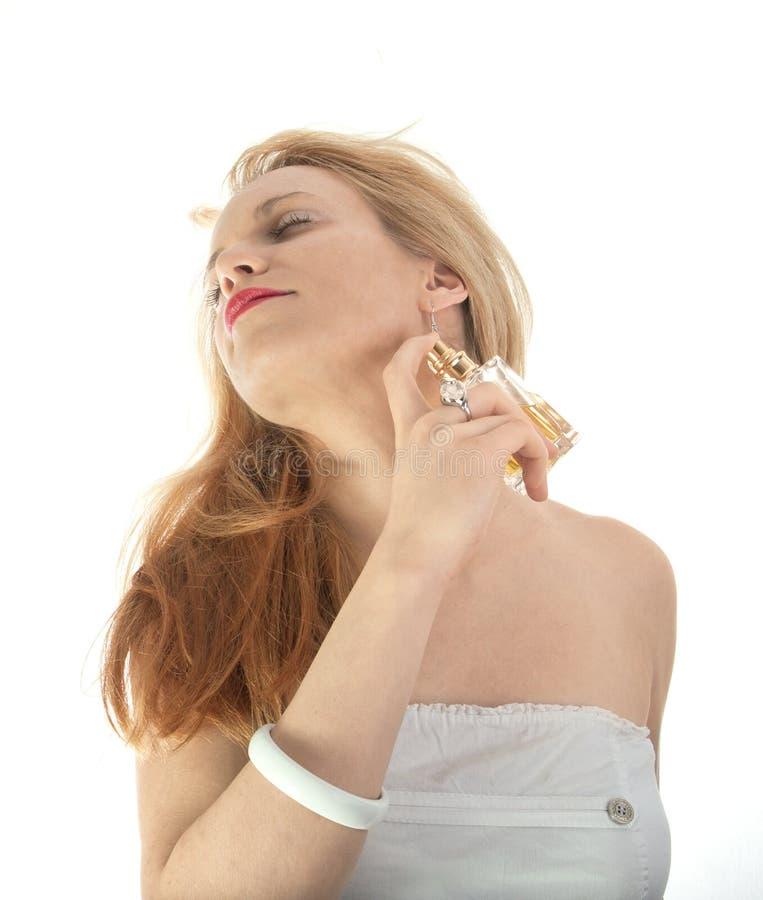 Ragazza bionda con profumo fotografia stock