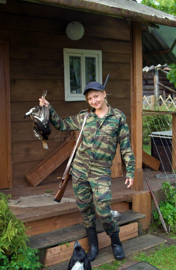 Ragazza-cacciatore. fotografia stock