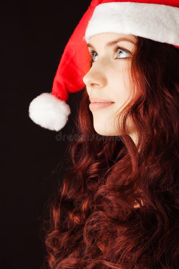 Ragazza in cappello del Babbo Natale immagine stock