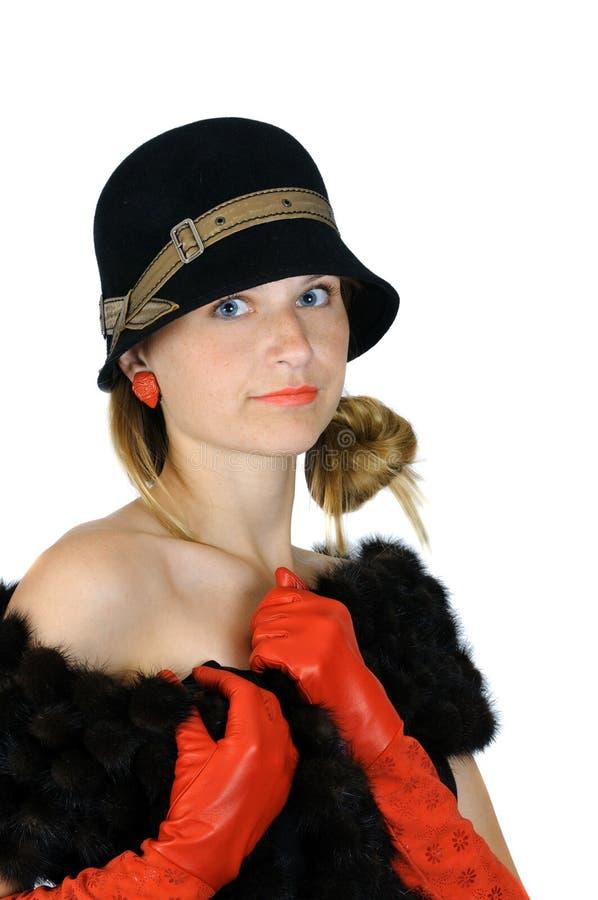 Ragazza in cappello ed in guanti rossi fotografia stock libera da diritti