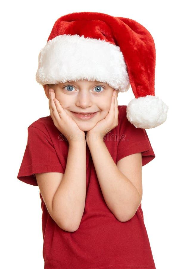 Ragazza in cappello rosso di Santa su bianco isolato immagine stock libera da diritti