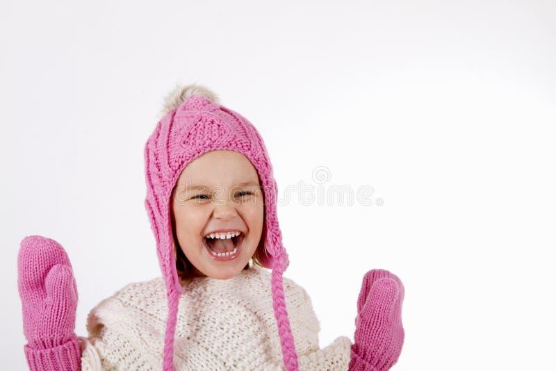 Ragazza in cappello tricottato e guanti fotografia stock