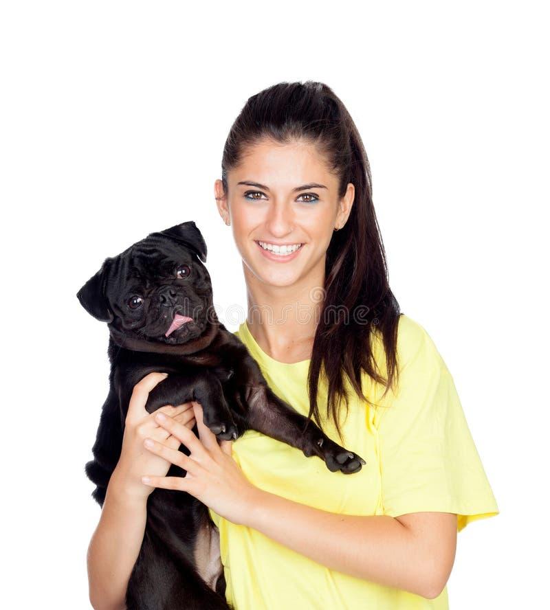 Ragazza castana con il suo cane del carlino fotografia stock libera da diritti