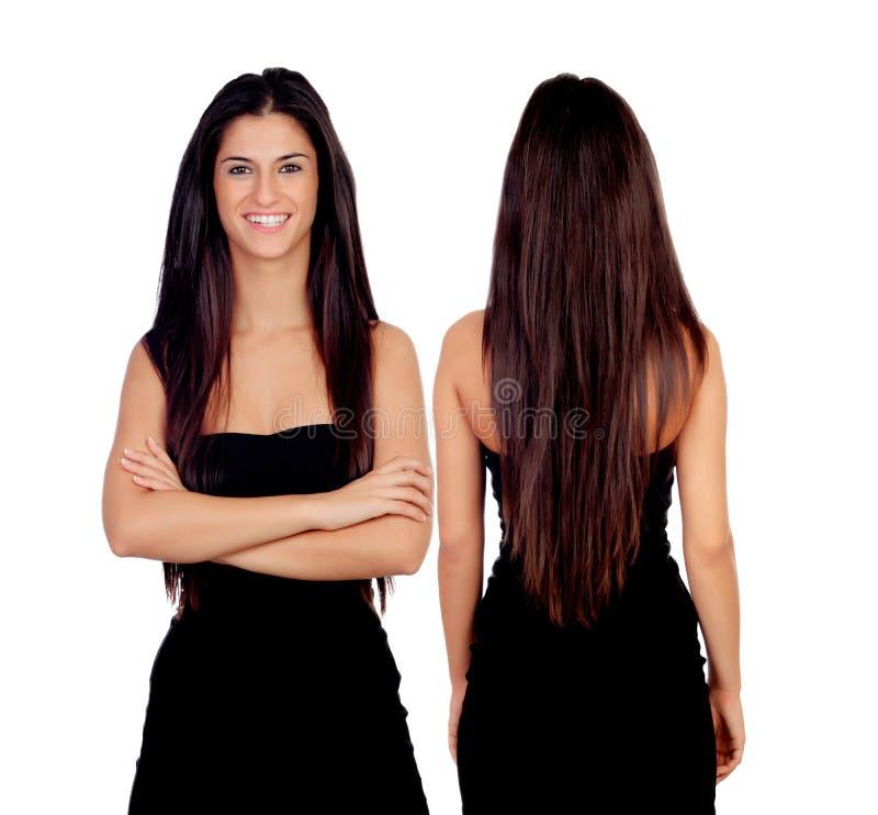 Ragazza castana con la parte anteriore e la parte posteriore nere del vestito immagine stock