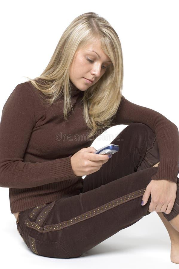 Ragazza/cellulare/bianco immagine stock libera da diritti