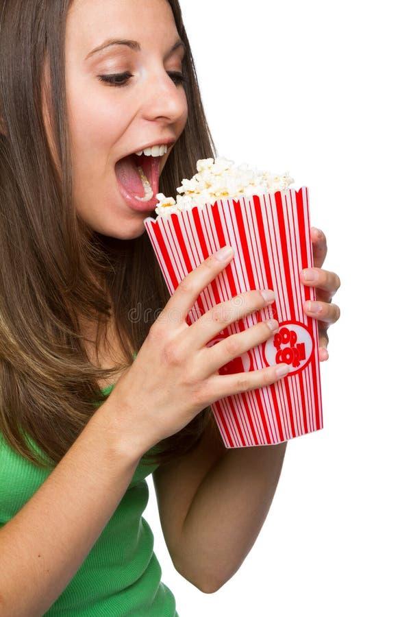 Ragazza che mangia popcorn immagine stock libera da diritti