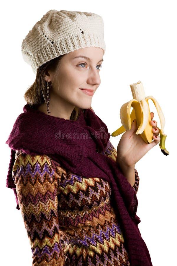 Ragazza che mangia una banana fotografie stock libere da diritti