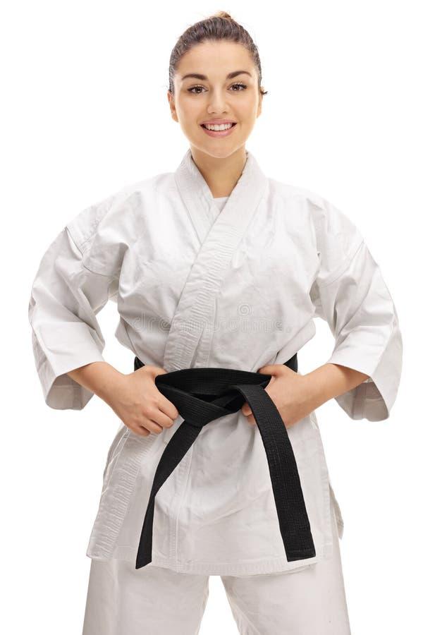 Ragazza che porta un kimono con una cintura nera immagine stock libera da diritti