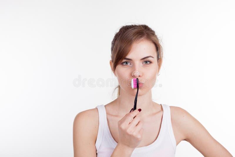Ragazza che tiene un'odontoiatria dello spazzolino da denti fotografie stock